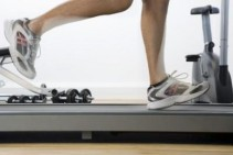 A treadmill mat reduces noise and protects your floor. Photo Credit BananaStock/BananaStock/Getty Images